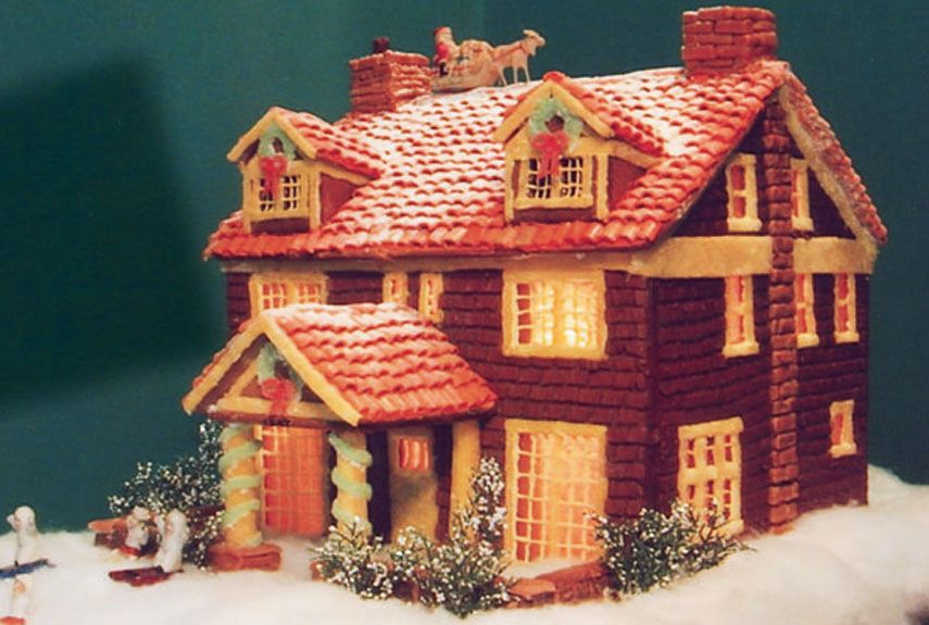 """Home Sweet Home Former Third-Place Winner Leila Mercorelli of Bolivar, OH, got the idea to re-create her former home when she found red """"shingle"""" candies in a store. Read more: Gingerbread Fenced House - Pictures of Gingerbread Houses - Good Housekeeping Follow us: @Good Housekeeping Magazine on Twitter 
