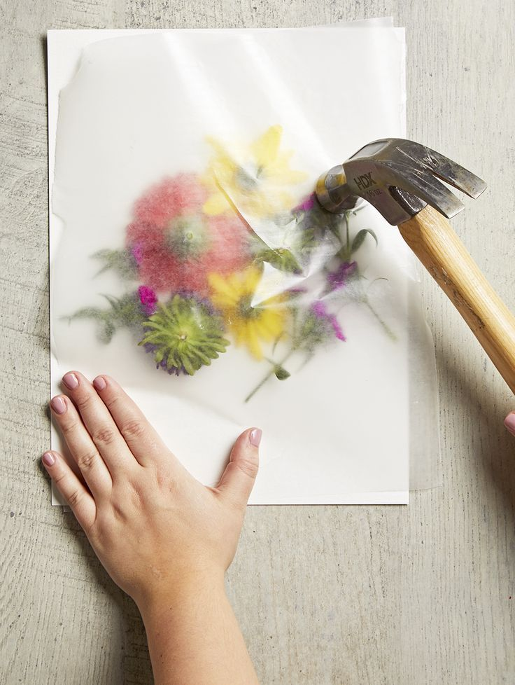 smashing flowers with hammer for coloring paper