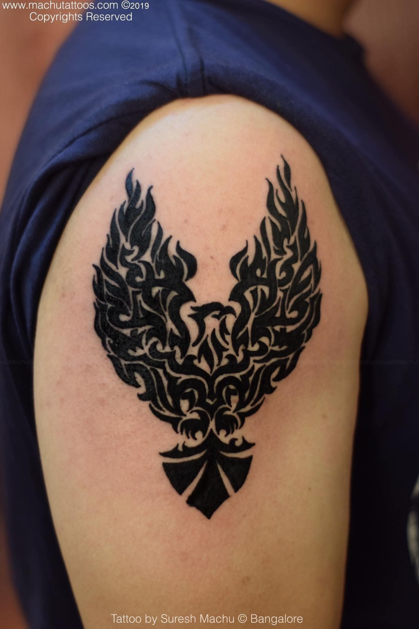 Men Biceps Tribal Tattoo With Pheonix And Eagle Done By Suresh