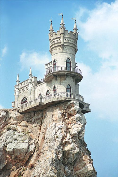 The Swallow's Nest is a decorative castle near Yalta on the Crimean peninsula in southern Ukraine. It was built between 1911 and 1912 in Gaspra, on top of 40-metre (130 ft) high Aurora Cliff, to a Neo-Gothic design by the Russian architect Leonid Sherwood.