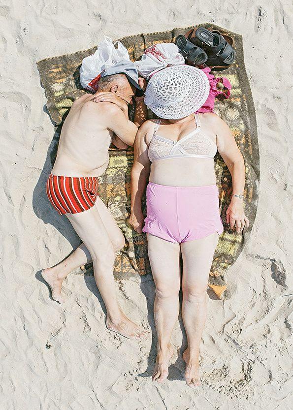 Tadao Cern photographs sunbathers in all their glory :: love this precious couple sharing the tiny blanket!