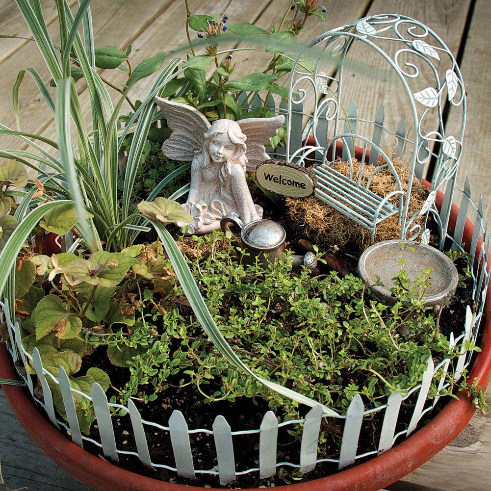Fairy Garden Container Ideas final touch up for the garden Garden Ideas