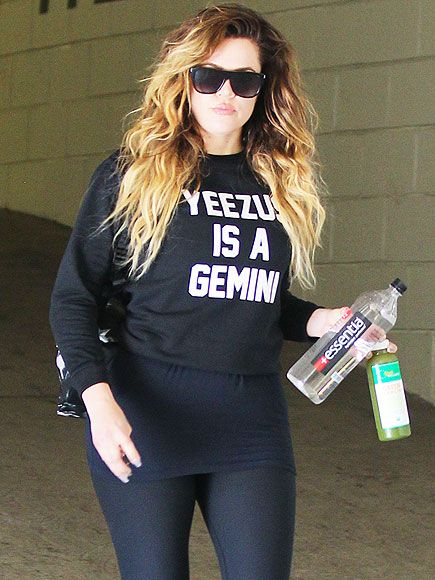 """Khloé Kardashian, rocking oversized flat-top square shades, supported her future bro-in-law by sporting a """"YEEZUS IS A GEMINI"""" tee! Love it!"""