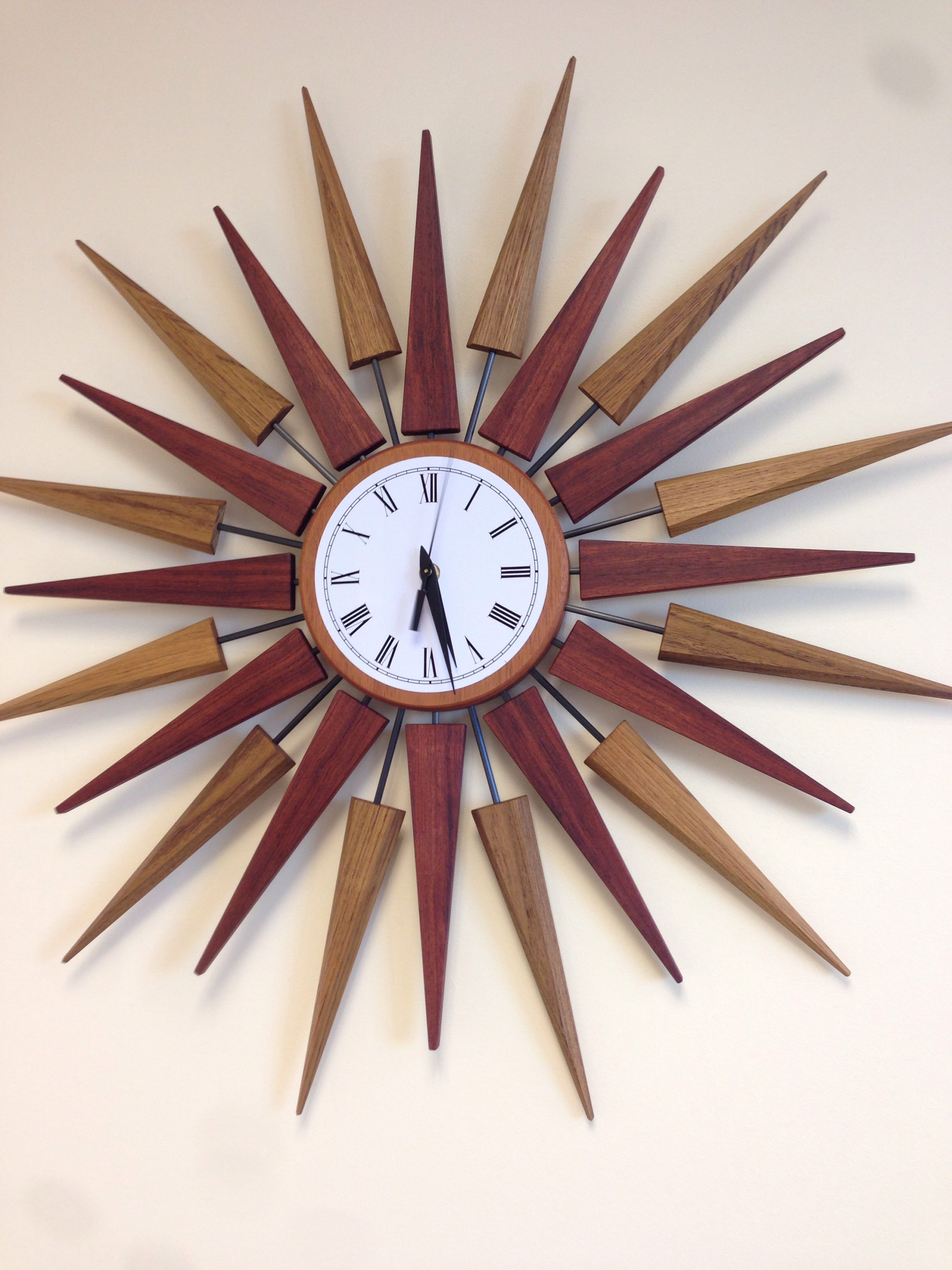 Midcentury modern sunburst wall clock 30 diameter bubinga and teak with carbon fiber rods by brownell furniture