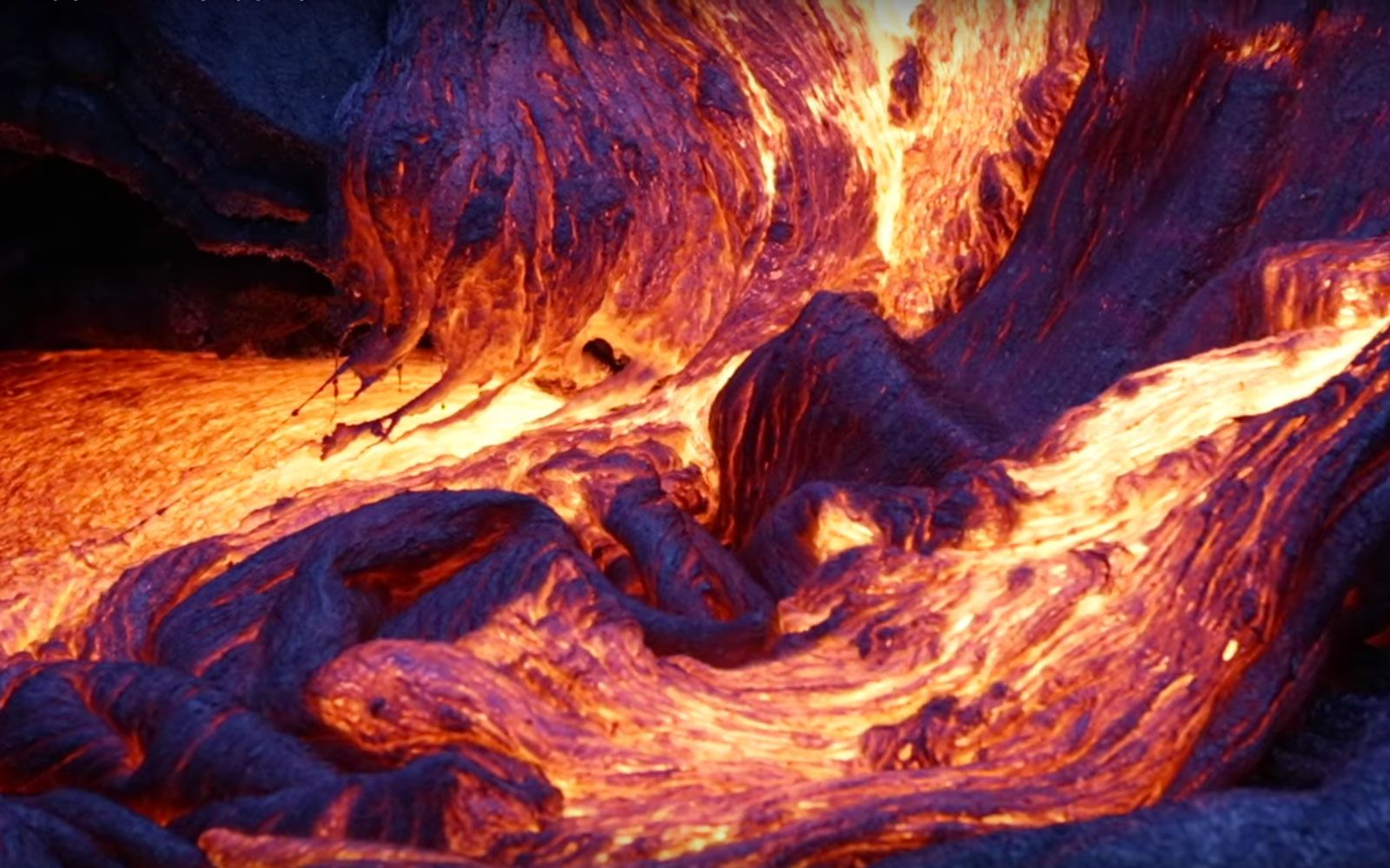 Watch Mesmerizing Blue Lava Erupt From This Hawaiian Volcano - Incredible neon blue lava flames erupt volcano