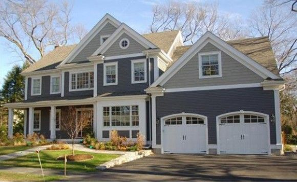 I love the white garage doors with the arched windows.