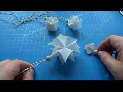 Zauberstern und Zauberflöckchen aus Papier basteln