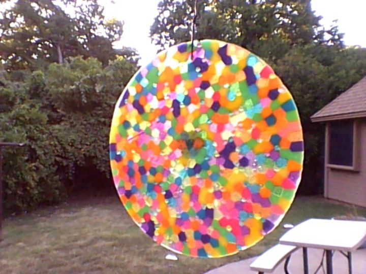 Suncatcher made by melting plastic beads in cake pan on