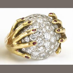 A diamond and red enamel ring, Salvador Dali Sold for US$ 36,000 inc. premium