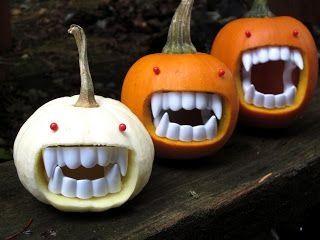 use fake vampire teeth to create this unique pumpkins have a fave pumpkin pin - Fake Halloween Pumpkins