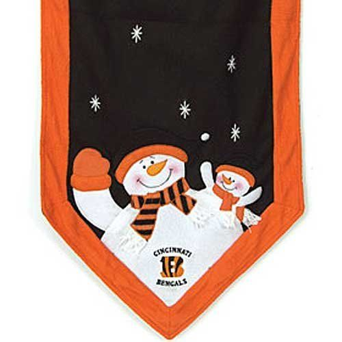 "Cincinnati Bengals NFL 72"" X 15"" Snowman Table Runner by Caseys. $30.99. SC Sports Snowman Table Runner. Decorate your table with this Snowman Table Runner. 72 inches long by 15 inches wide, this plush table runner features a snowman parent and child at each end dressed in your favorite teams colors, along with the team logo and embroidered stars. Add the Table Top Snowman Family to complete the look!. Decorate your table with this Snowman Table Runner. 72"" long by 15..."