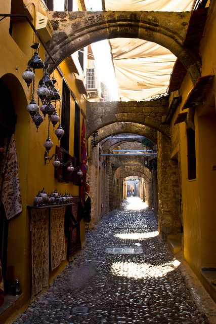 Beautiful historic alley, Rhodes, Greece| http://www.greeceviewer.com/odigos/en/Rhodes%20city