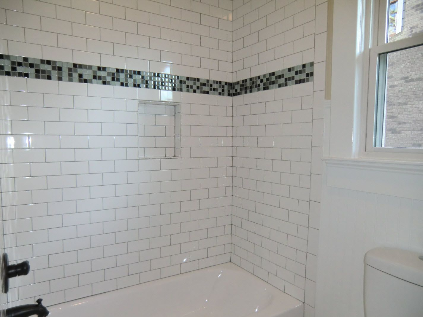Subway Tile Bathroom | Guest Bath tub with subway tile surround ...