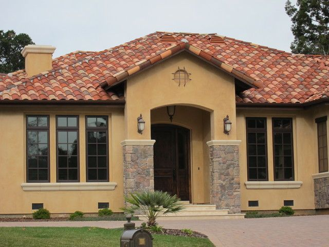Paint colors arched entrance dark windows lake house for Spanish style exterior