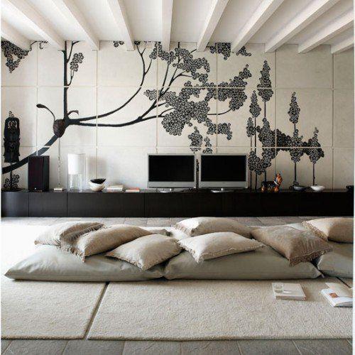 Maisons · une photo dune jolie décoration intérieure moderne avec des coussins de sols couleur caramel