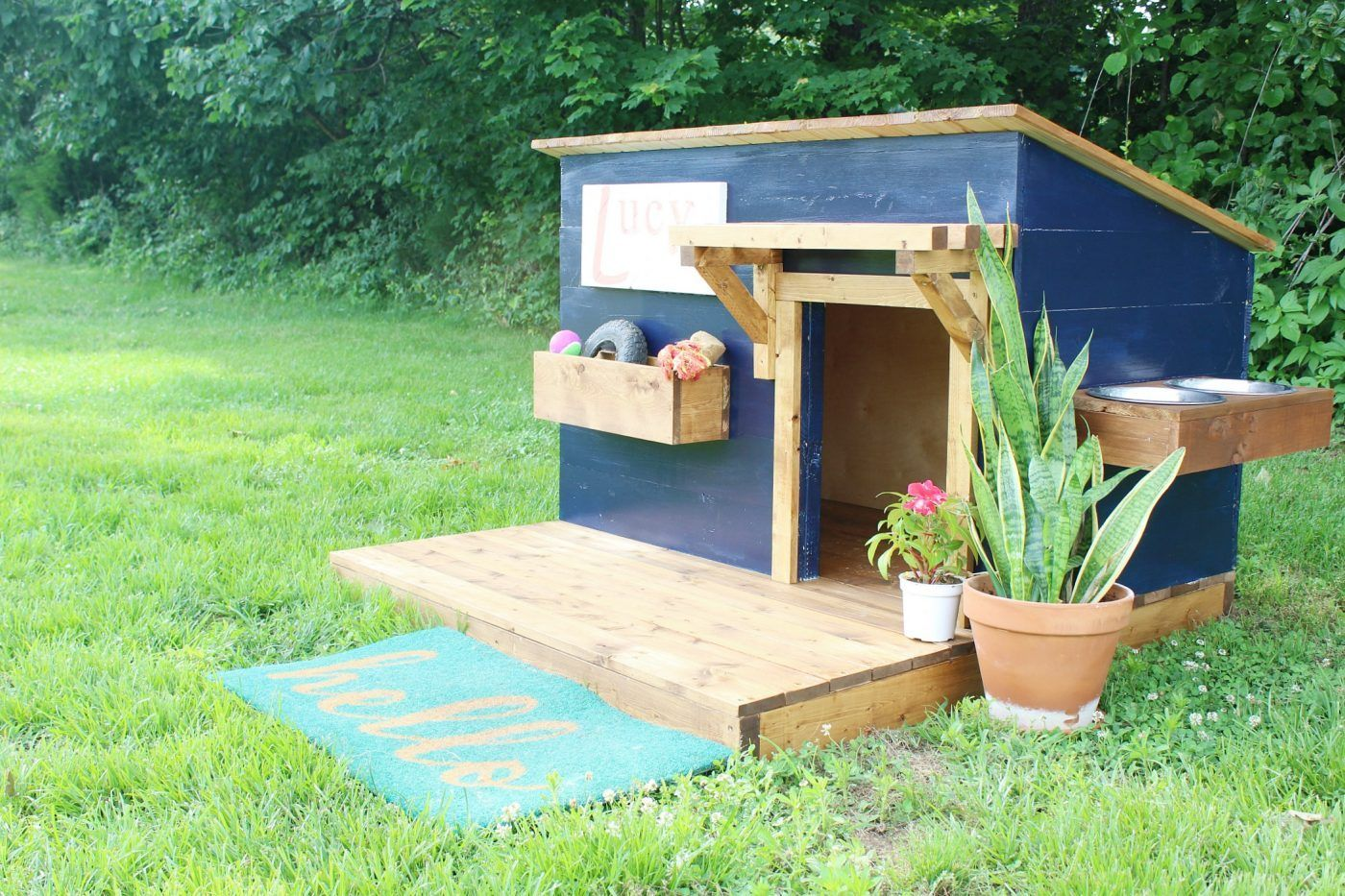 diy doghouse with deck, toy box, and food bowl | dogs + dog
