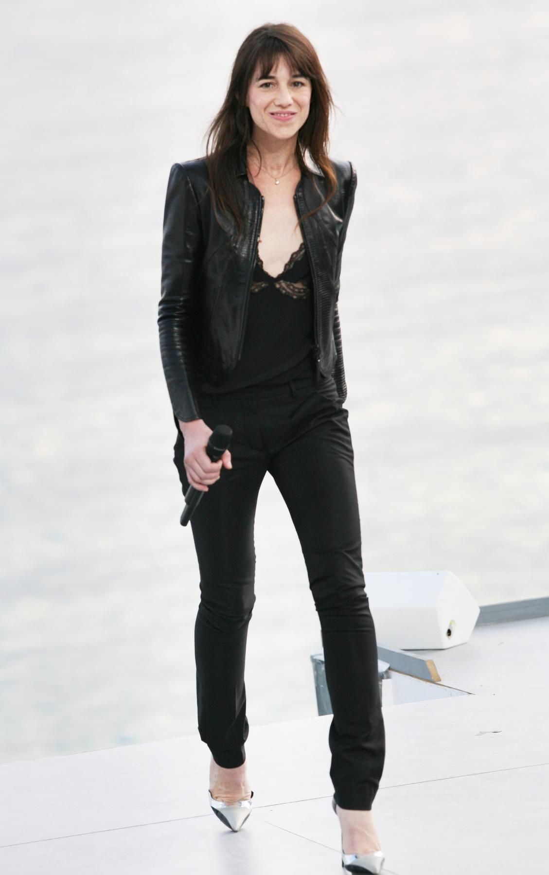 The Charlotte Gainsbourg Look Book - sleek black jeans, cami & leather jacket, interesting shoes.
