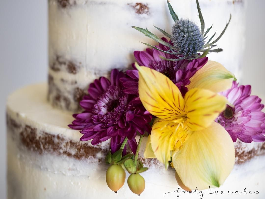 Close-up of this bright, compact little fresh flower arrangement on a neat seminaked cake  loving the dusty purple thistle thing and the peachy-coloured berry things (and you can all enjoy my extensive flower knowledge/vocabulary ). Hope you're all having a lovely weekend! Xx