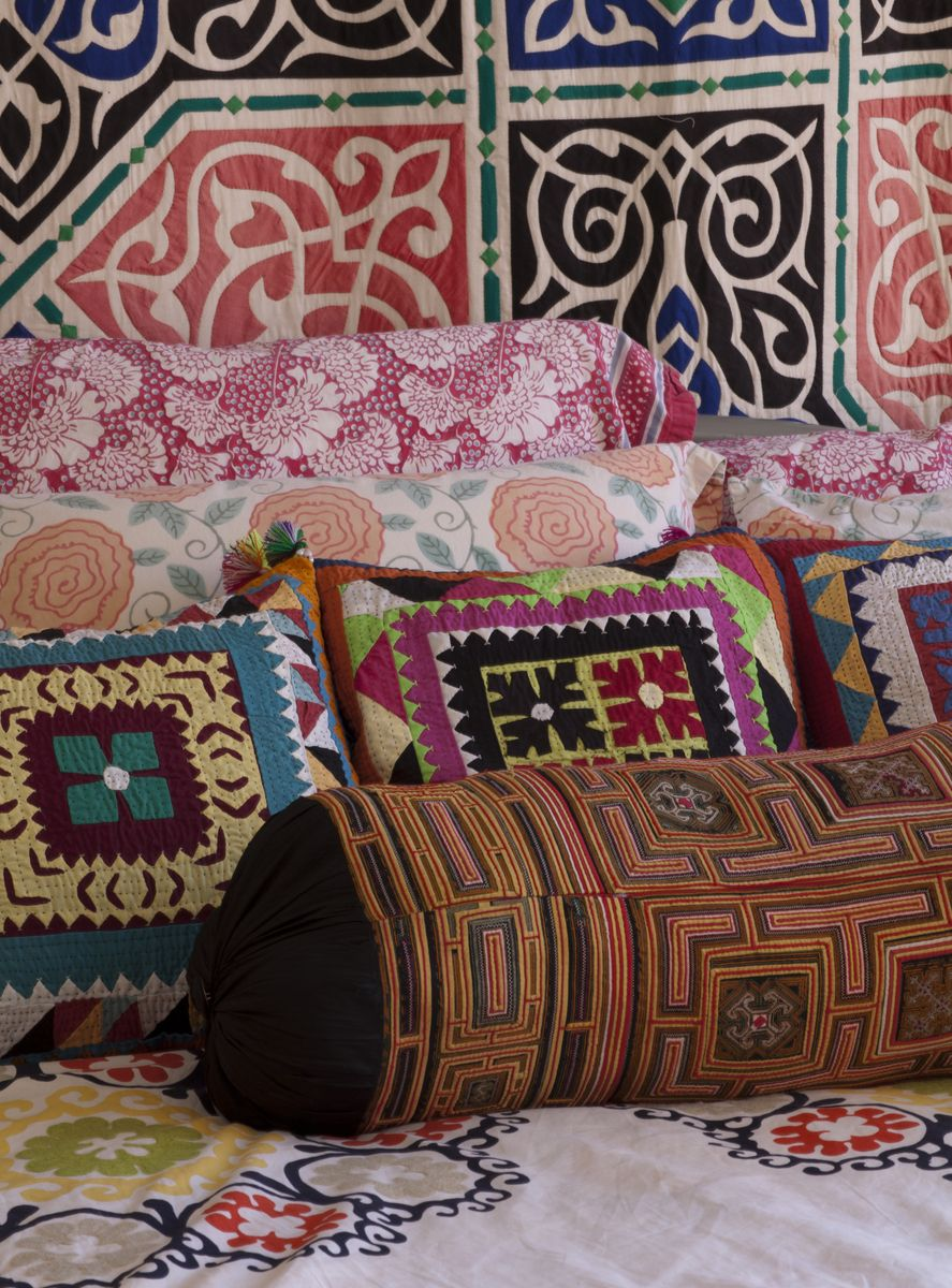 Wall - Quilt, The Tentmakers of Chareh El-Khiamiah reverse appliqué embroidery, Egypt   Cushions small - Ralli Quilts: The traditional Textiles reverse appliqué, embroidery, Sindh Valley, Pakistan large - Block print, Rajasthan, India bolster - pintucks and embroidery, Miao Hill Tribe, Guizhou Province, China