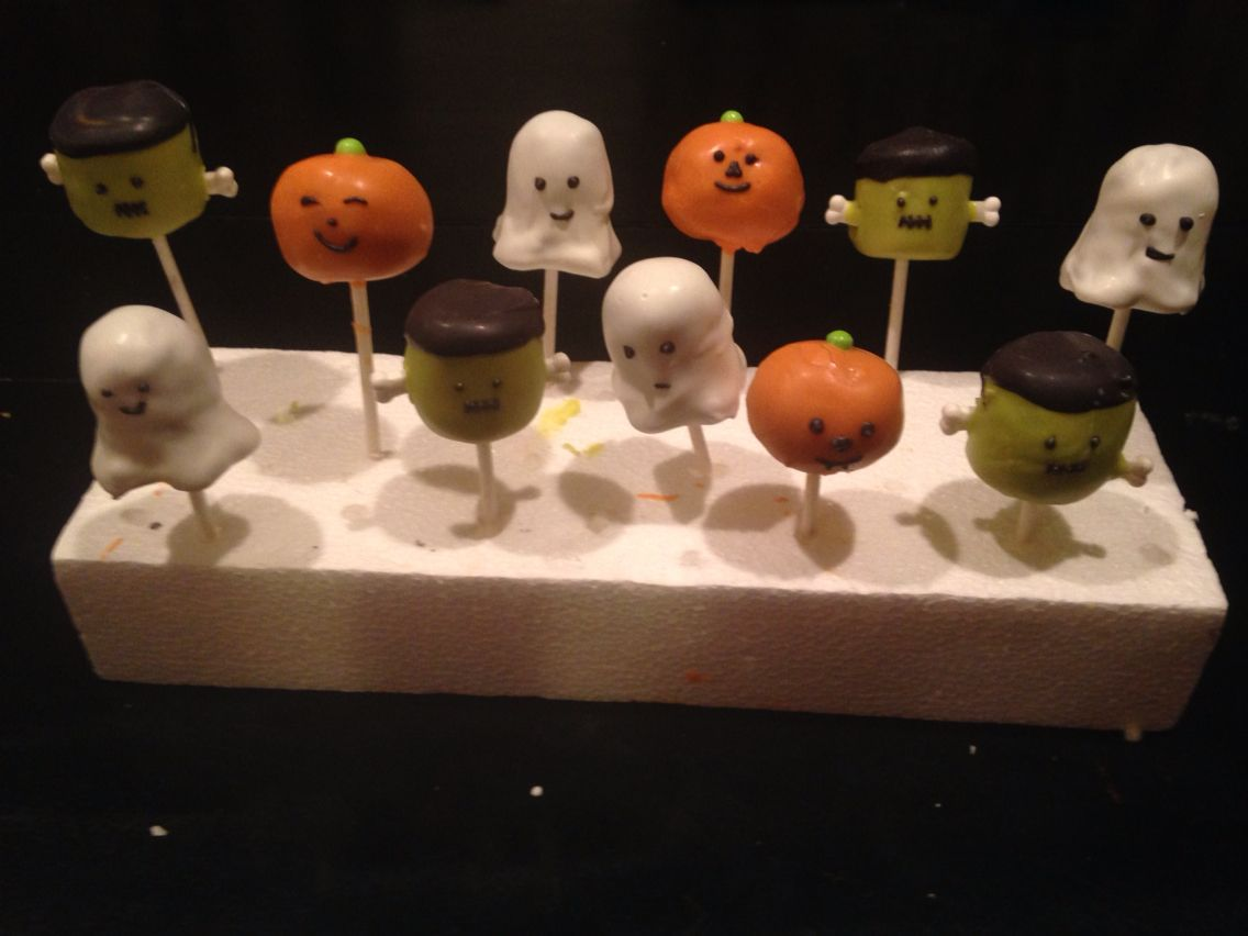 Cake pops dipped in candy melt shaped in different figures