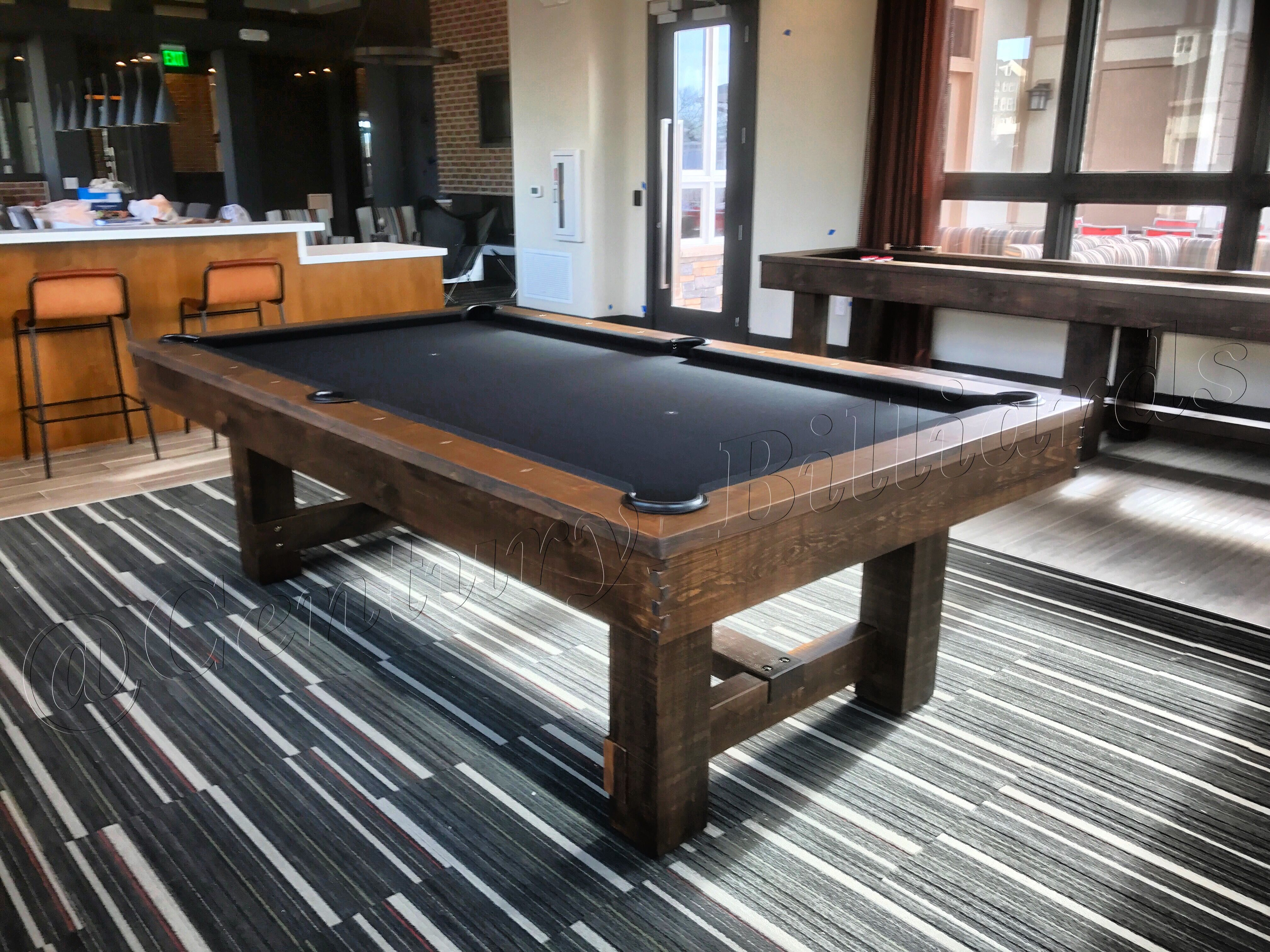 Rustic pool table featuring black billiards cloth by Century Billiards, NY.