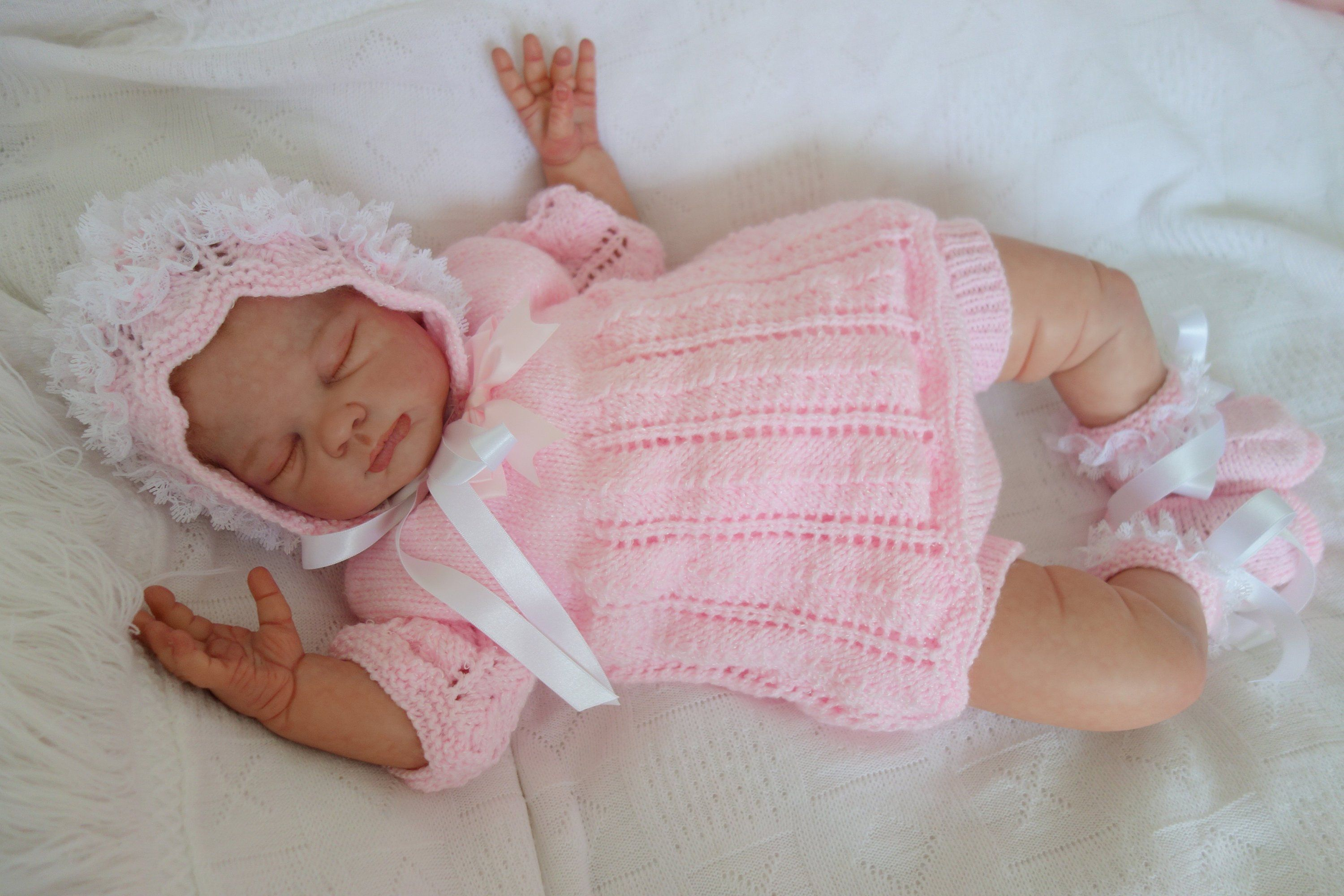 780622a2722f Hand knitted frilly pink baby set. Angel top