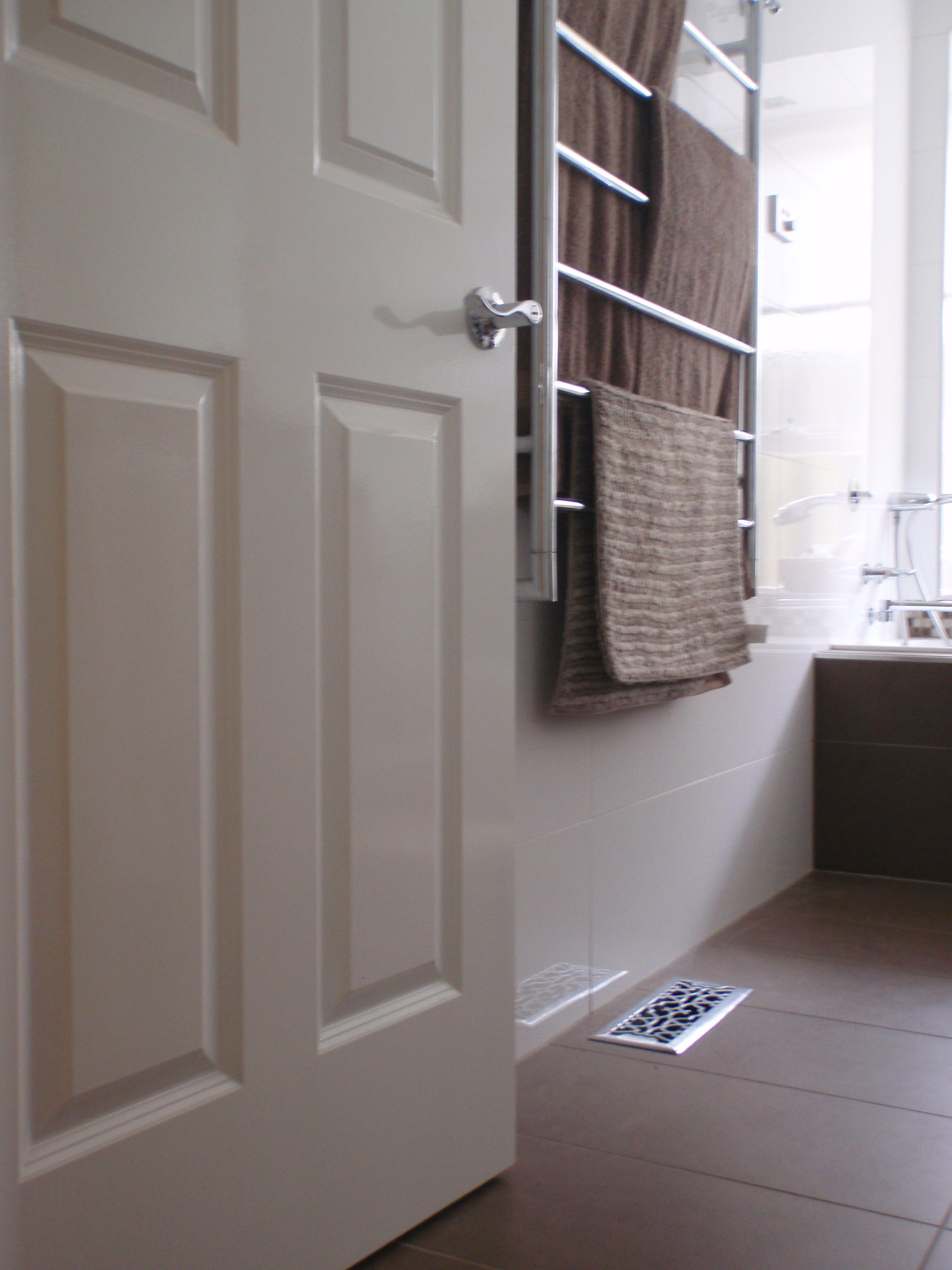 Welcome to my bathroom... Brown and white tiles, heated towel rail, fluffy towels, heaven...