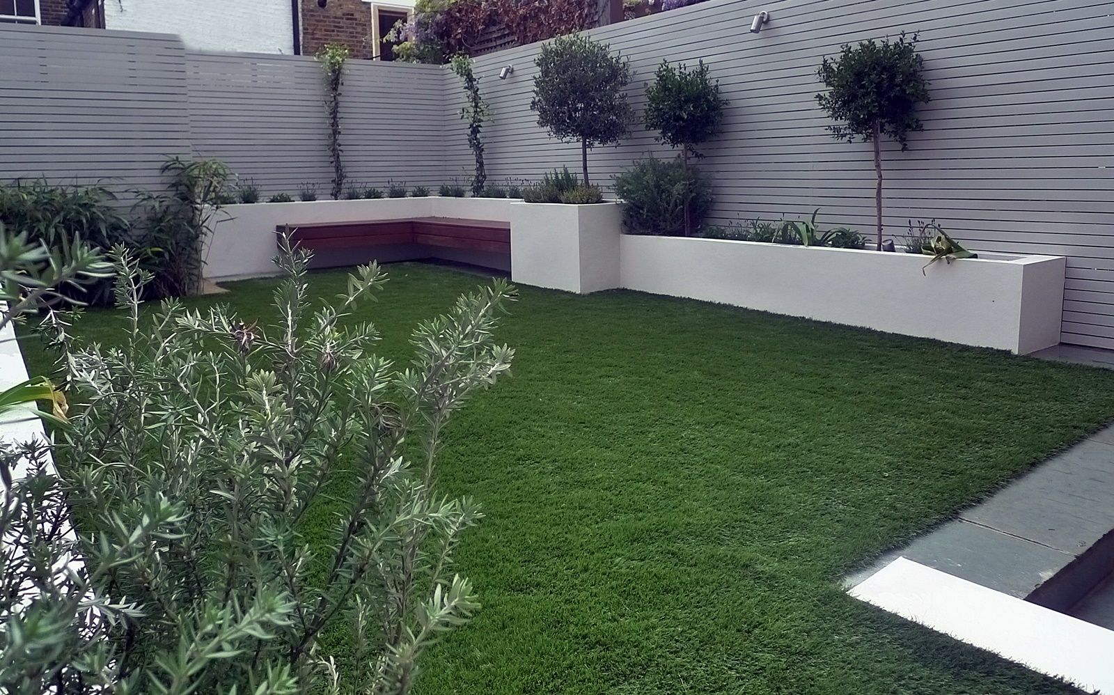 Artificial Grass Garden Designs sawn sandstone paving easy grass raised beds hardwood screen and bench balham garden design london Artificial Grass Easi Grass Modern Garden Designers And Design London