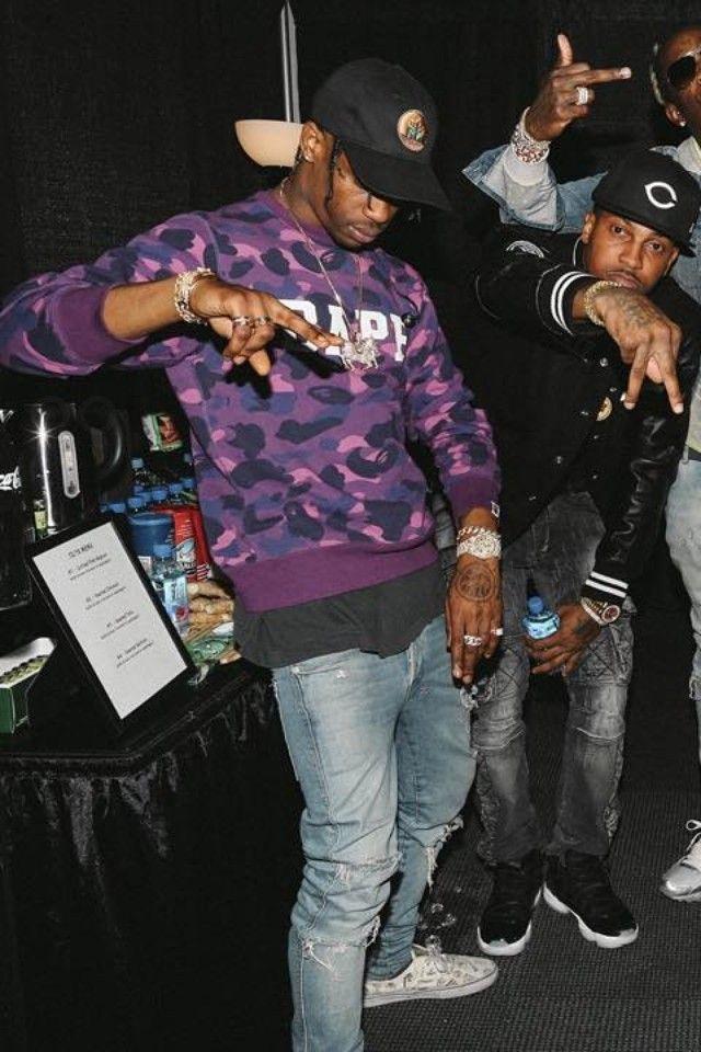 e2fff0075b9f Travis Scott wearing Bape Camo Sweater, Nick Bhindi Custom Horse Pendant  Chain , Off-Brand Travis Scott Madness Tour Cap