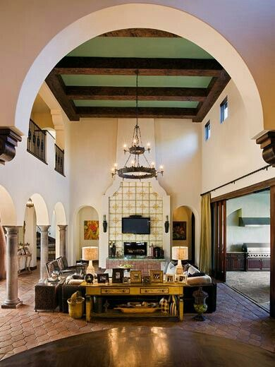 Two Story High Living Room With Exposed Beam Ceiling