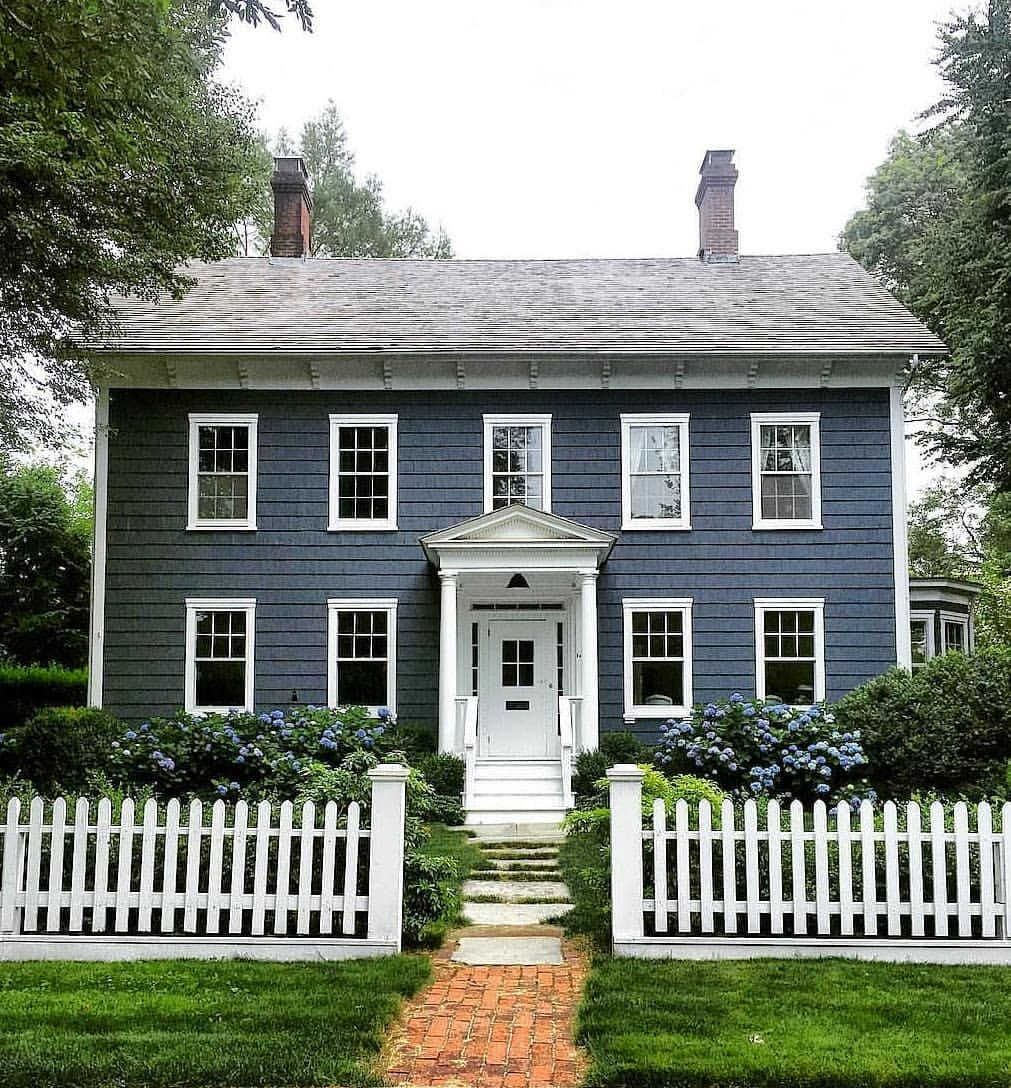 Love How The Dark Blue Color Brings A Little Drama To This Traditional Beauty Photo Via Skaufman House Exterior Blue Colonial Exterior House Paint Exterior
