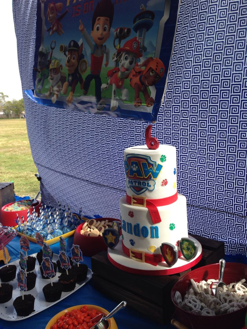 PAW PATROL PARTY for a 6 year old paw patrol lover. This candy station / dessert station had sweets in dog bowls!