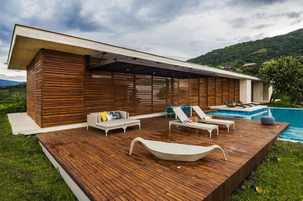 Captivating Architecture: Wooden Sun Deck With Modern Lounge Chairs Outdoor Day Bed And  Swimming Pool And
