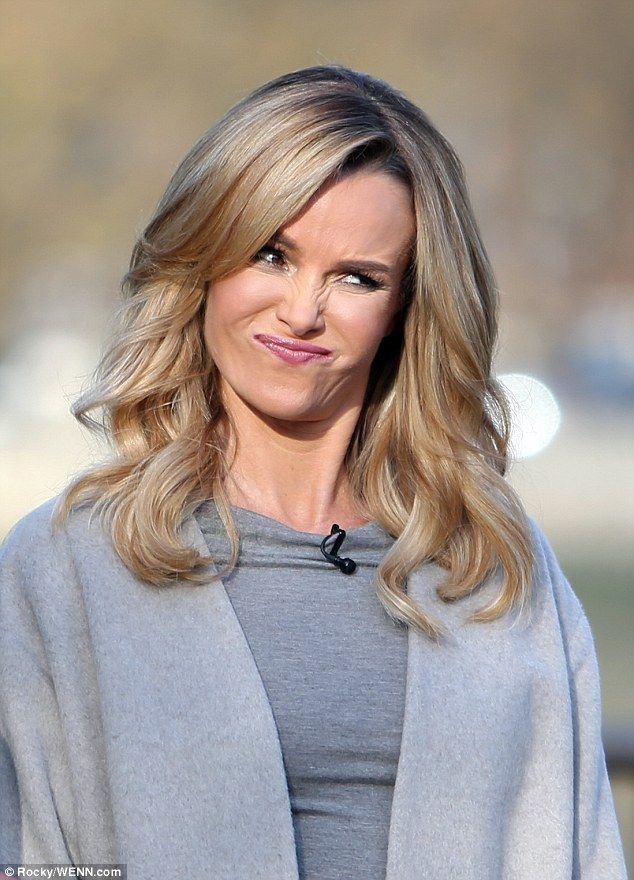 Amanda Holden catches the eye in bold yellow dress at