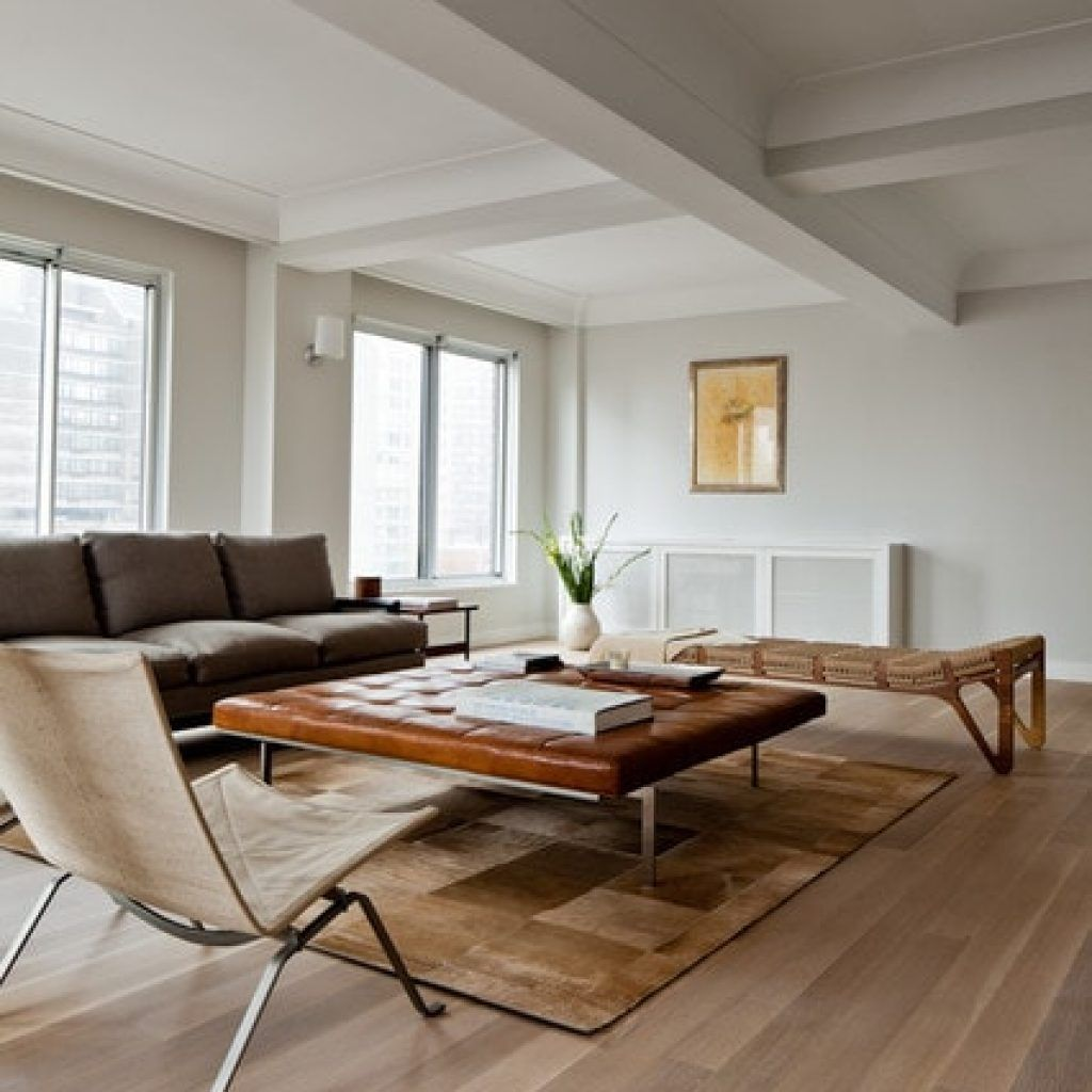 Contemporary Living Room Wtih White Oak Flooring Furnished Among Grey Fabric Sofa Also Brown Leather Coffee