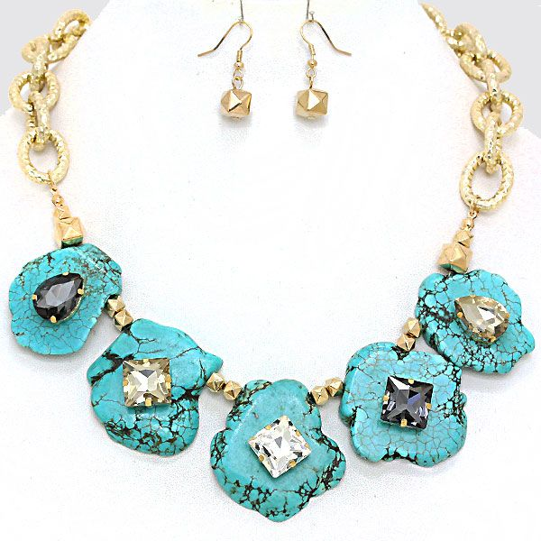 Take Your Time With It. Slow down. You move too fast for this lady.  Giant turquoise colored natural stones with smoke and clear colored rhinestones are set on a shiny gold chain.   This necklace set is big and heavy and rockin' (literally).  A touch of boho. A touch of class. A whole lot o...