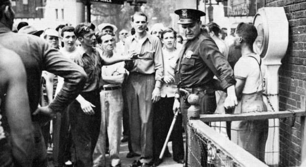 Detroit race riot 1943 detroit police officers defend blacks from the white mob although the dpd was criticized for being indifferent to many of the brawls