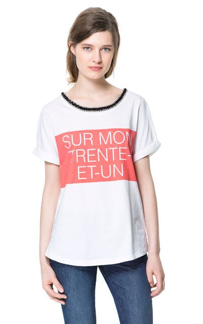 Image 1 of T-SHIRT WITH APPLIQUÉ from Zara