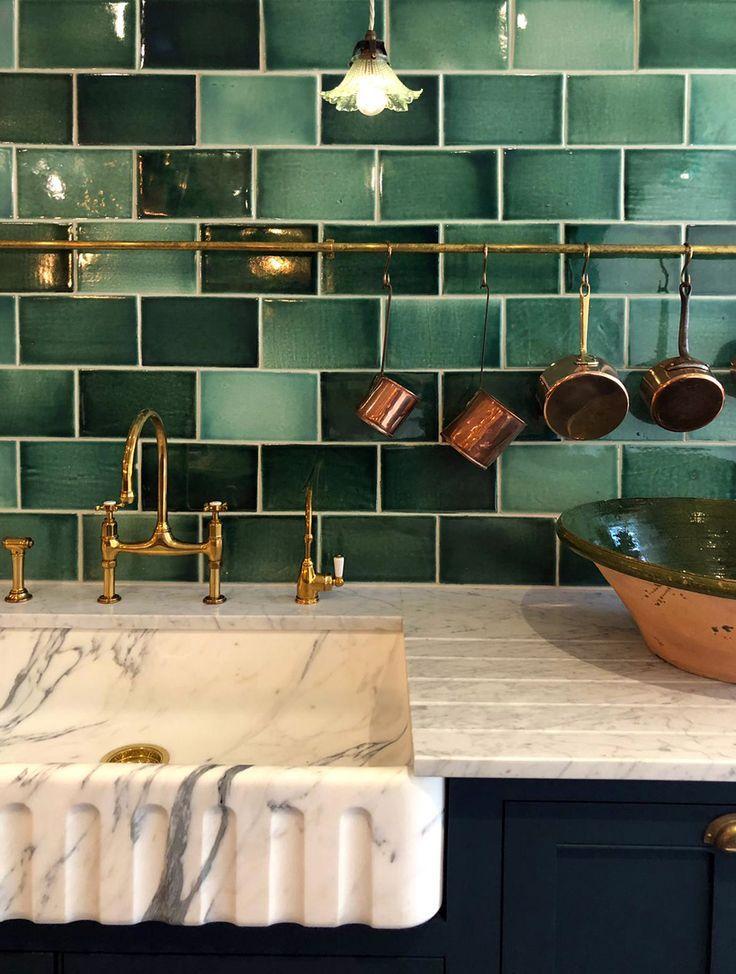 green backsplash with brass faucet
