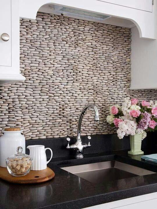 River stone kitchen backsplash. So serene.