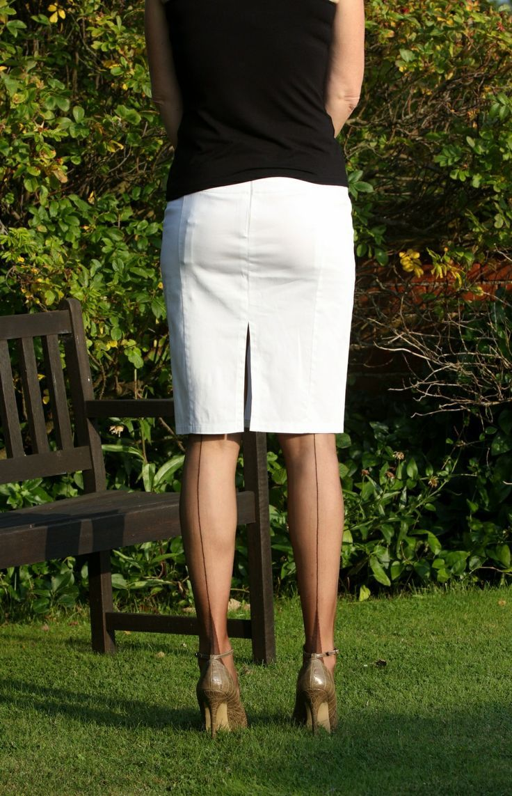 suspender bumps Visible Garter Bumps Under White Pencil Skirt Black Top Sheer Black Back  Seam Stockings and Black
