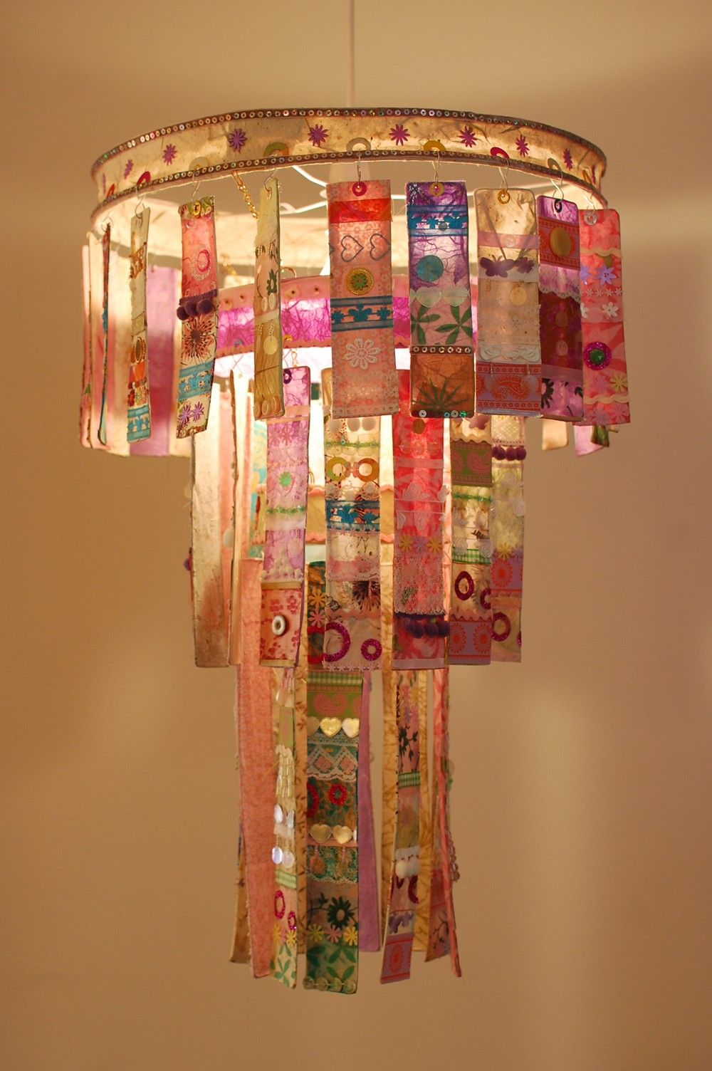 Three tier paper chandelier by louise traill radiance radiance three tier chandelier by louise traill a three tier chandelier made from paper mache strips of handmade paper and adorned with shiny sequins arubaitofo Gallery
