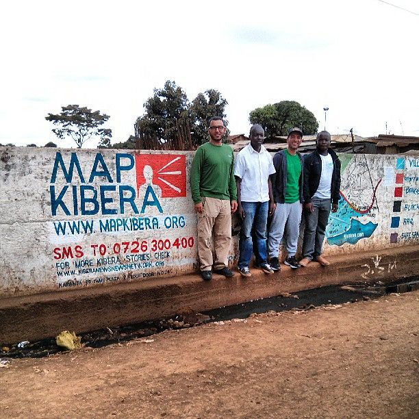 We stopped for a pic in front of a @MapKibera wall, complete with a map, contact info and legend. Very helpful! #Kenya #Nairobi @peymanparham @wildpeeta