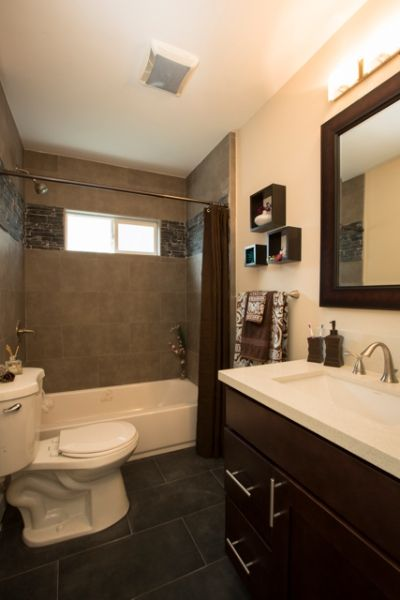 Bathroom With Dark Grey Tile Floors Tiled Shower White Sink And Chocolate Brown Accents