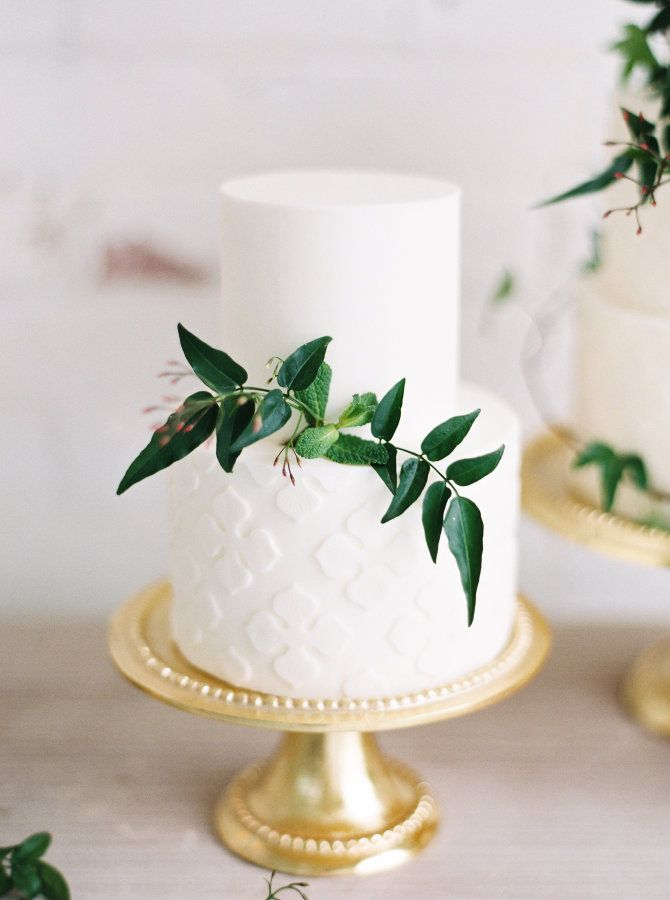 Two tier wedding cake with greenery: http://www.stylemepretty.com/2017/03/27/modern-warehouse-wedding-ideas/ Photography: Kristine Herman - http://www.kristineherman.com/