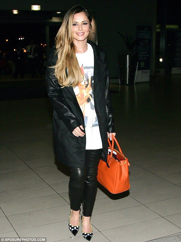 Cheryl Cole Wearing Givenchy Bambi Tee Dkny Cargo Jacket With Leather Sleeves Giuseppe Zanotti Yvette Printed Satin Pumps And Prada Saffiano Gardener S