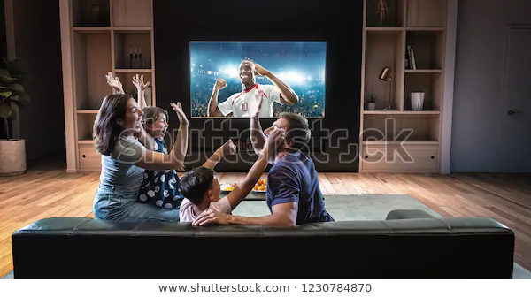 Family Watching Soccer Moment On Tv Stock Photo Edit Now 1230784870 In This Moment Tv Photo Editing