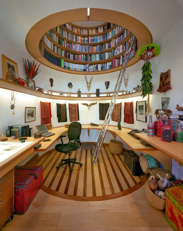 Wade Davis' Office: This library is built like the rotunda of the Oracle's Temple of Delphi with natural lighting from the top. I want this!