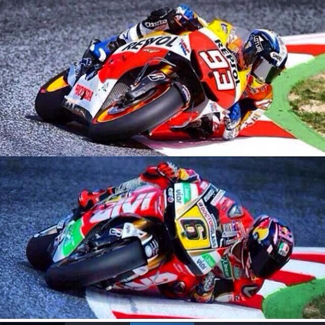 Motogp Riders Demonstrating The Awesome Lean Angle Achieved During