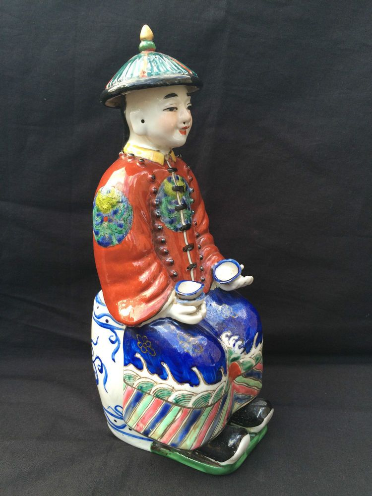 Asian porcelain figurine symbols